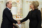 Владимир Путин и Хиллари Клинтон (слева направо)