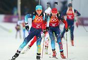 Ukrainian biathlete Vita Semerenko (L) and Russia's Yana Romanova (R)