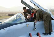 North Korean leader Kim Jong-un (C) inspecting a fighter plane (archive)