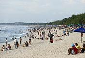 Tourists crowd a beach in Kuta Bali, Indonesia
