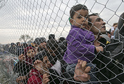 Migrants awaiting entry into Macedonia on the Greek side of the border
