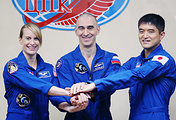 Kathleen Rubins, Anatoly Ivanishin and Takuya Onishi
