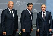 Lebanese multimillionaire Fouad Makhzoumi, former French Prime Minister Francois Fillon and Russian President Vladimir Putin in St. Petersburg, June 19, 2015