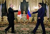 Russian President Vladimir Putin and Japanese Prime Minister Shinzo Abe