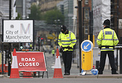 Police officers stand guard close to Victoria Railway Station in Manchester, Britain after a terror attack