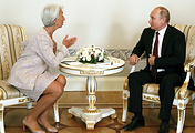 Director of the International Monetary Fund Christine Lagarde and Russian President Vladimir Putin