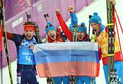 Российские биатлонисты Антон Шипулин, Алексей Волков, Евгений Устюгов и Дмитрий Малышко (слева направо), завоевавшие золотые медали в эстафете 4x7,5 км на Олимпиаде-2014