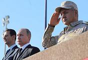 Президент Сирии Башар Асад, президент России Владимир Путин и министр обороны России Сергей Шойгу на российской авиабазе Хмеймим