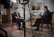 Президент России Владимир Путин и журналист, ведущий телеканала Fox News Крис Уоллес