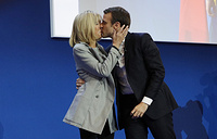 French presidential election candidate for the 'En Marche!' (Onwards!) political movement, Emmanuel Macron kisses his wife Brigitte Trogneux after the first round of the French presidential elections in Paris, France, April 23
