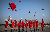 Chinese stewardesses throw their hats at Tiananmen Square before the closing ceremony of the 19th National Congress of the Communist Party of China at the Great Hall of the People in Beijing, China, October 24