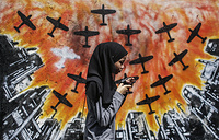 A woman passes by a work of art featured in the street art project 'Laman Seni' in Shah Alam, Malaysia, December 5. Laman Seni was organized by a local council to encourage creativity among youth and student artist