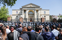 People gather outside the Residence of the President of Armenia in Marshal Bagramyan Street during a mass protest against the election of former President Sargsyan as Prime Minister