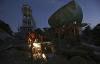 Rescue teams search for victims in the rubble caused by an earthquake at a Mosque in North Lombok, Indonesia
