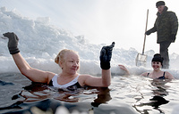Members of a winter swimming club bathe in an ice hole on Lake Boyarskoye, Tomsk, February 10