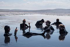 People taking a mud bath in Crimean Chokrakskoe lake