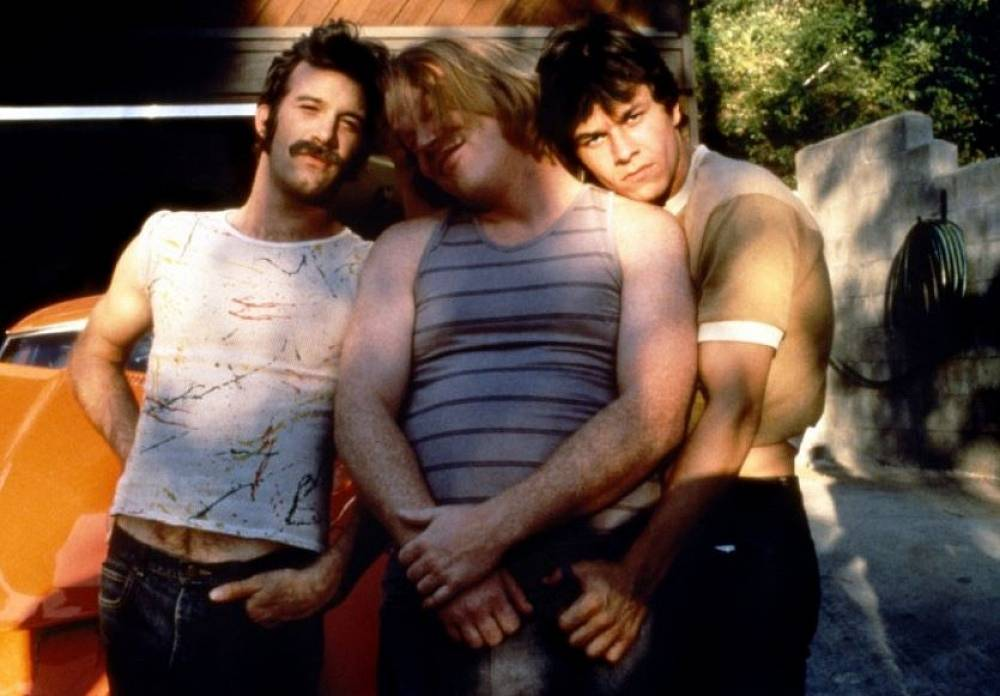 "A close friend of Paul Thomas Anderson, Hoffman starred in almost all of his films. Photo: scene from ""Boogie Nights"" featuring Hoffman (center)"
