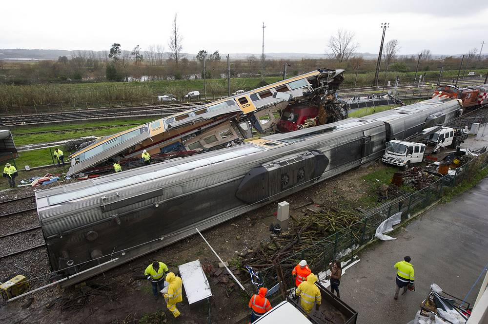 A high-speed intercity train rear-ended a local train waiting to enter a station in central Portugal Jan. 22, 2013. More than 20 people were injured
