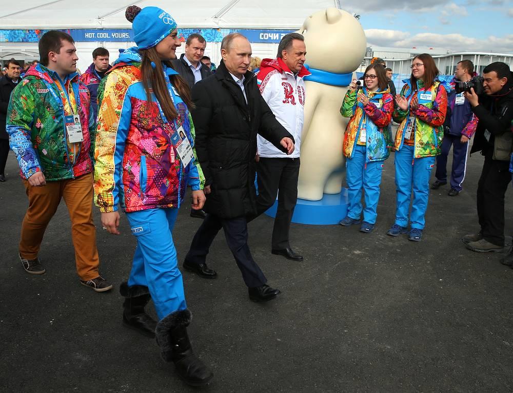 Pole vaulter, coastal Olympic village mayor Yelena Isinbayeva, Russia's president Vladimir Putin, and sports minister Vitaly Mutko (L-R) visiting the Olympic village in the coastal cluster