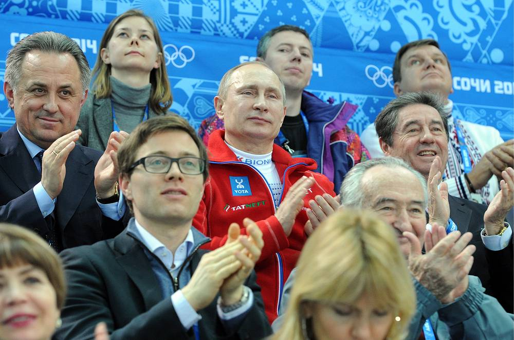 Russian President Vladimir Putin (C) and Russian Sports Minister Vitaly Mutko (L) watch the Figure Skating team event at the Sochi 2014 Olympic Games
