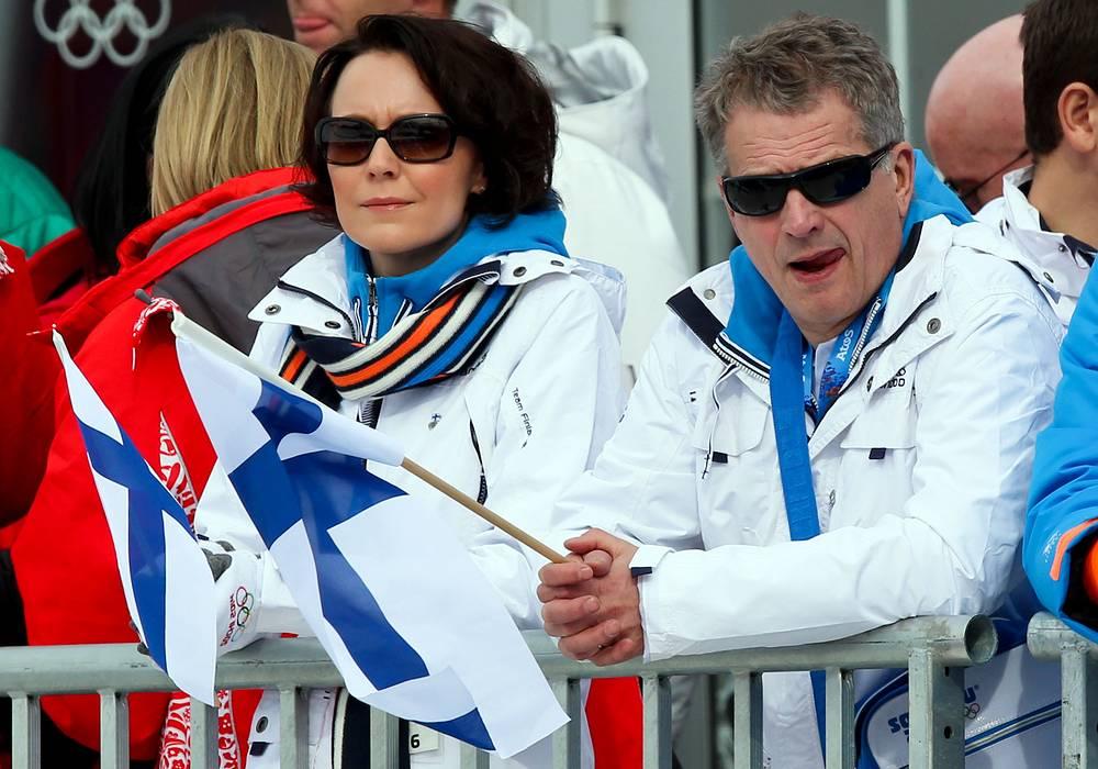 The President of Finland Sauli Niinisto and his wife Jenni Haukio watch Women's Snowboard Slopestyle final
