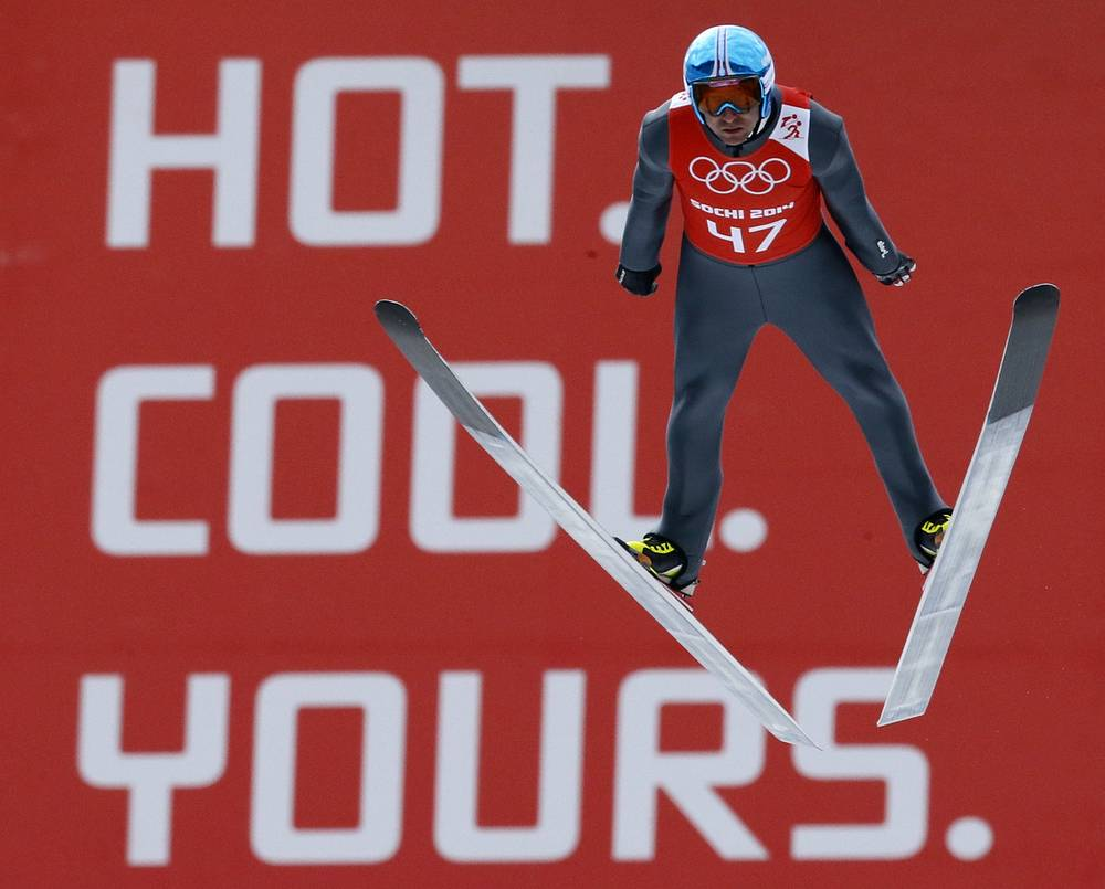 Austria's Mikko Kokslien soars through the air during a men's nordic combined training session
