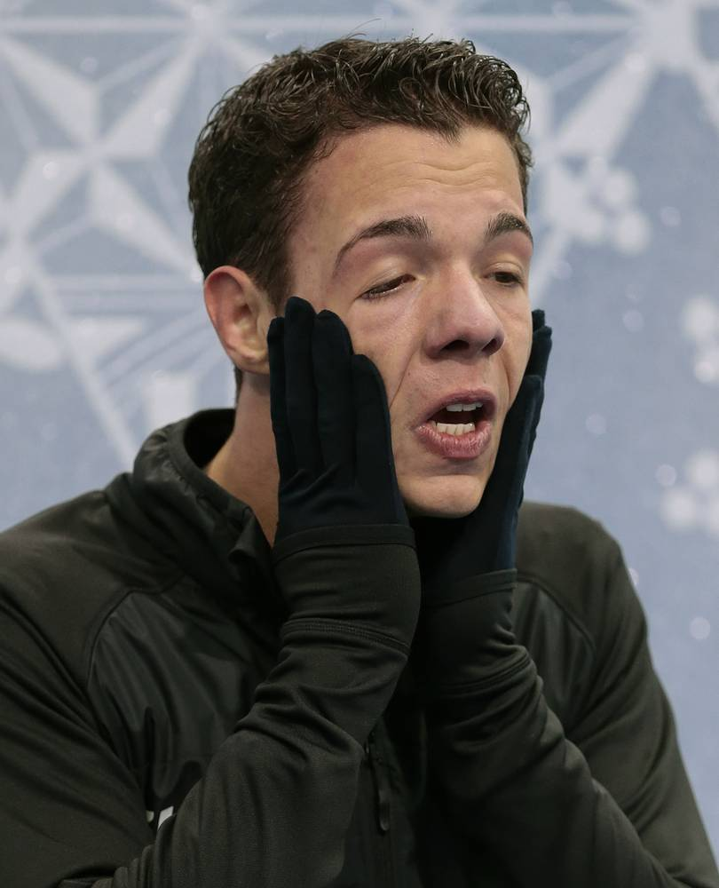 Jorik Hendrickx of Belgium reacts as he sits in the results area after competing in the men's free skate figure skating final
