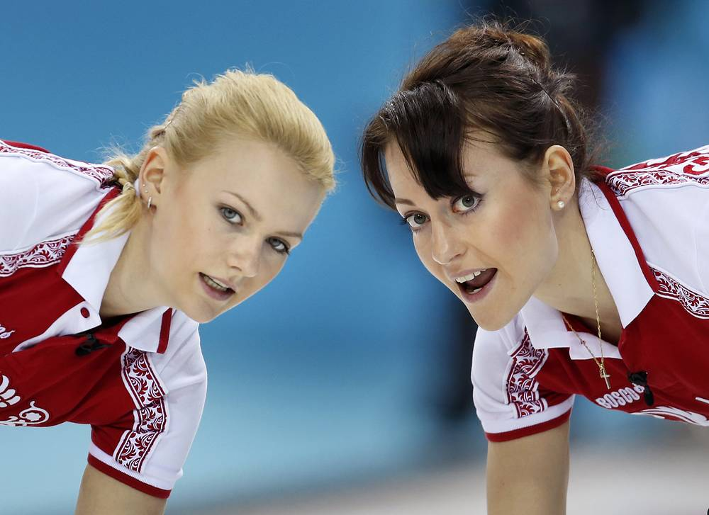 Russia's Alexandra Saitova (L) and Ekaterina Galkina during women's curling competition