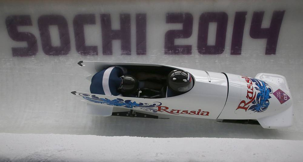 Russian pilots Alexander Zubkov and Alexei Voevoda win gold in two-man bobsleigh