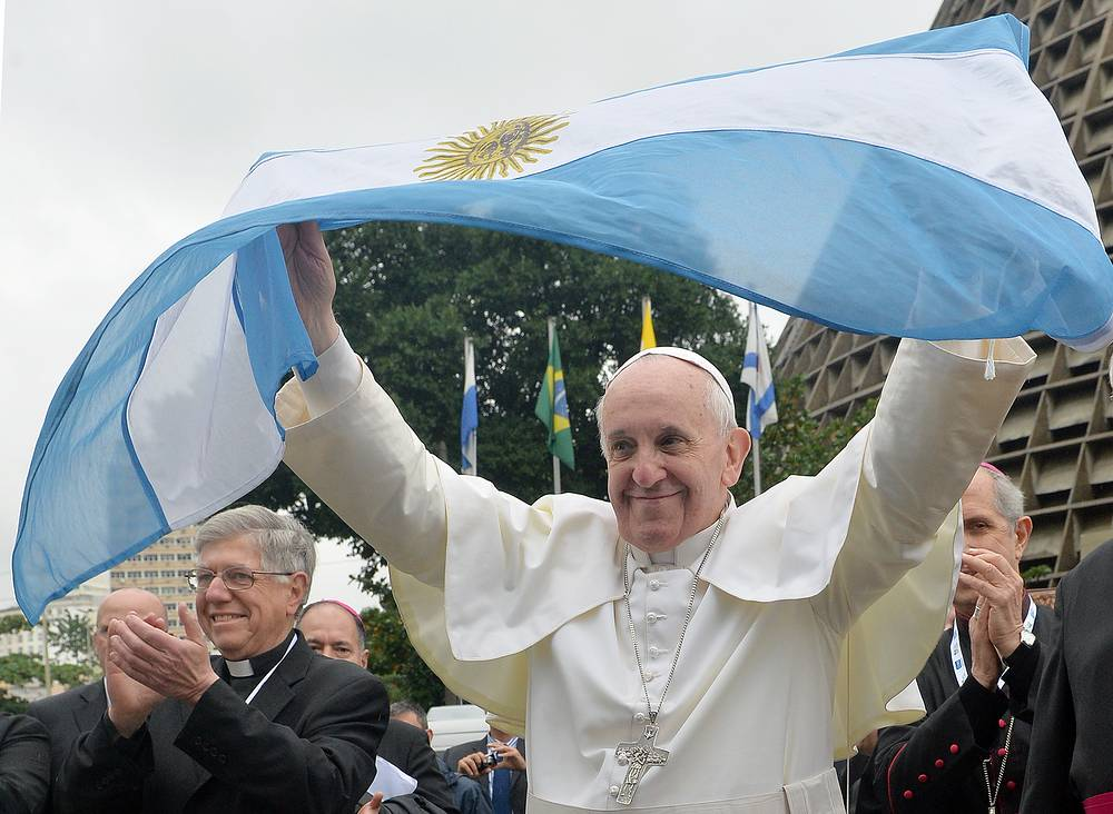Pope Francis waves an Argentinean Flag on his first trip overseas to Brazil