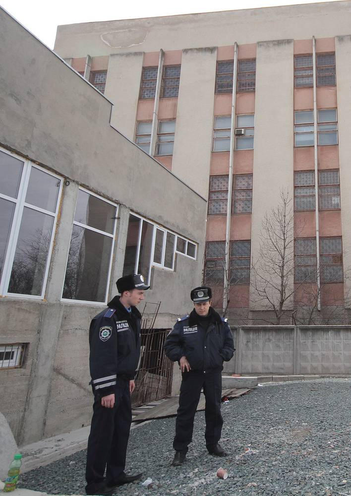 Crimean police at the military unit in Simferopol where the shooting incident took place