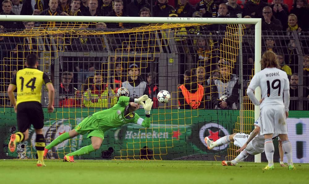 Dortmund's goalkeeper Roman Weidenfeller saves a penalty shot