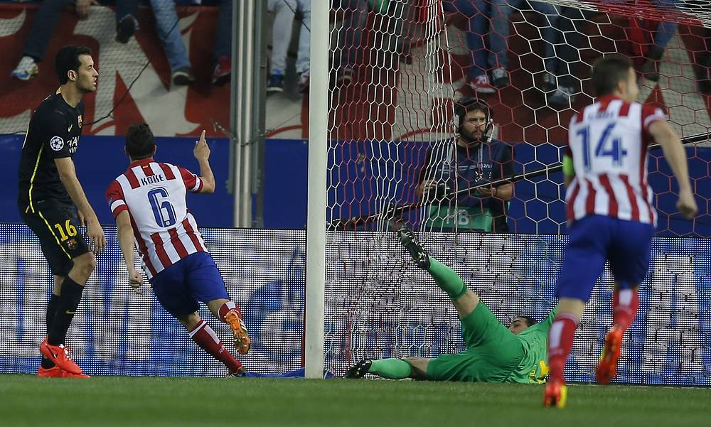 Atletico's Koke celebrates after scoring the opening goal