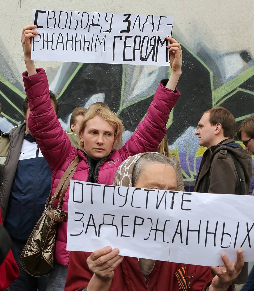 protesters hold placards reading 'Freedom for detained heroes!' during a rally near the district court in Kharkiv