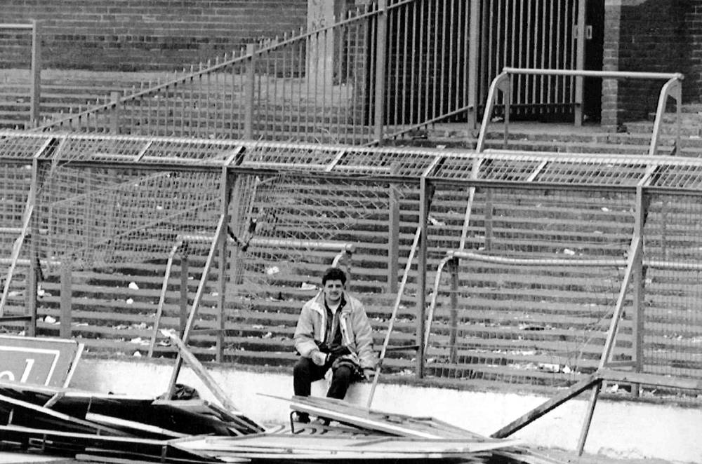 The game was stopped on the 6th minute. The police took the attempts of fans to get out of the stampede for attemts to break through to the pitch. Photo: a supporter sits by the damaged fencing at Hillsborough Stadium April 15, 1989