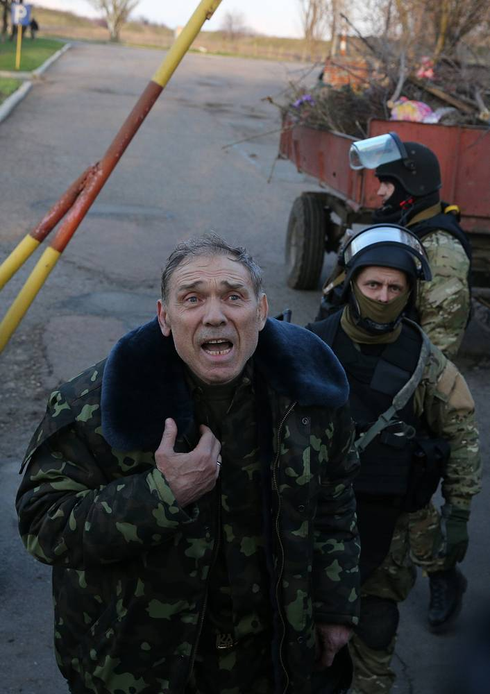 Commander of the military operation Gen. Vasily Krutov talks to protestera at Kramatorsk air base