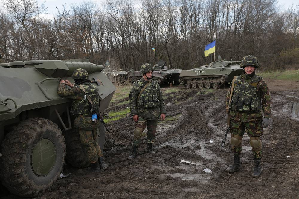 Ukrainian soldiers near their armed military vehicles not far from Izyum city, Kharkiv Region