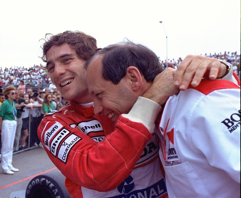 Ayrton Senna hugs McLaren team director Ron Dennis