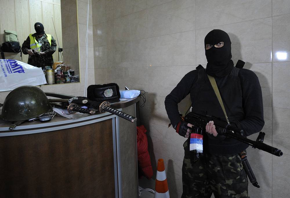 Armed men at the occupied Office of Public Prosecutor
