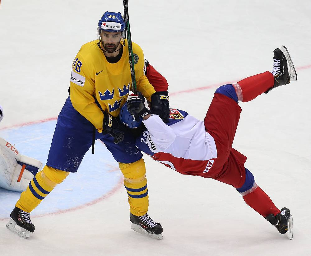 Sweden's Daniel Rahimi (L) and Czech Republic's Martin Zatovic