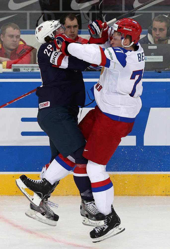 US Jake McCabe (L) and Russia's Anton Belov