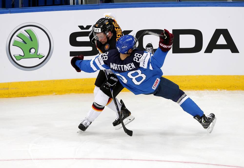 Yannic Seidenberg (L) of Germany in action against Finland's player Jyri Marttinen
