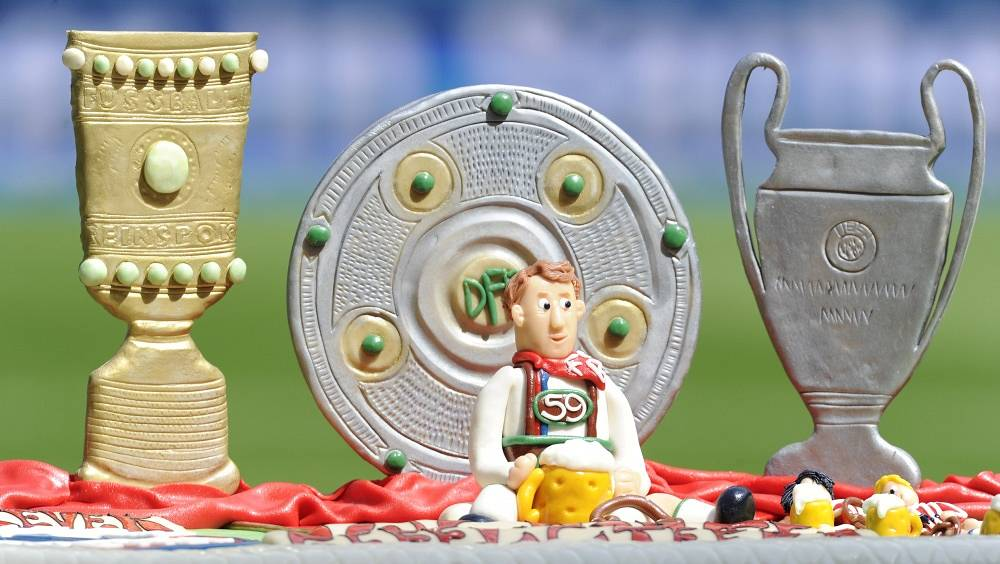 A birthday cake with 'sweet trophies' for Louis van Gaal