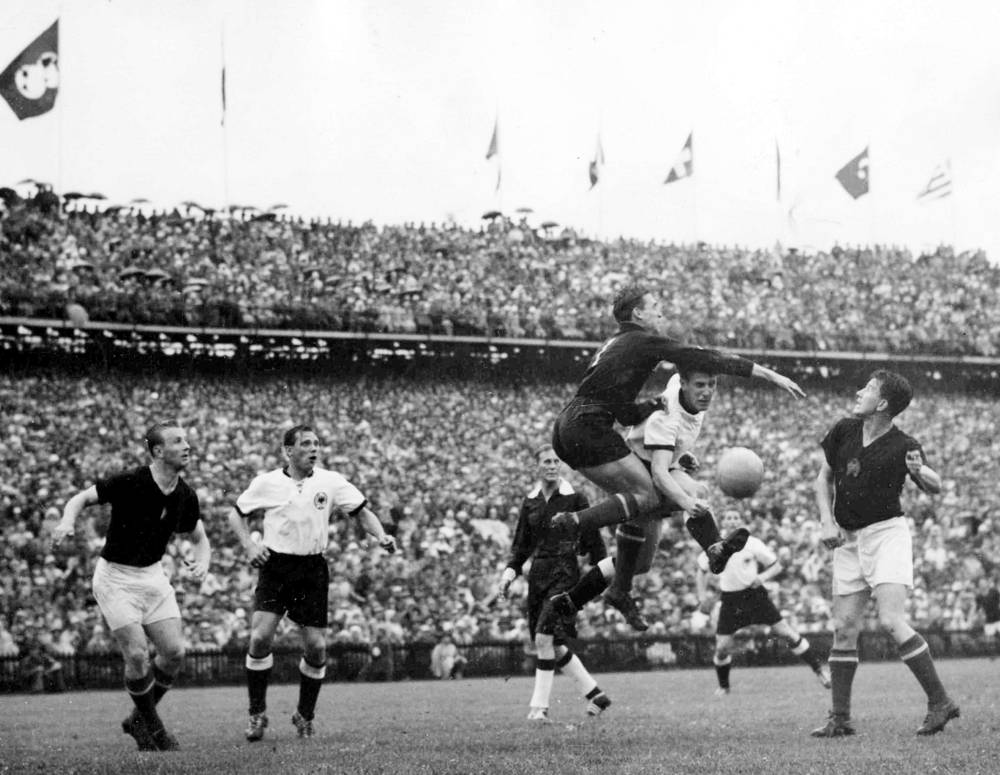 Switzerland World Cup 1954 saw Hungary and West Germany as finalists. The German team won with the score of 3-2. Photo: Hungarian goalkeeper Gyula Grosits jumps to clear the ball from German right-winger Helmuth Rahn