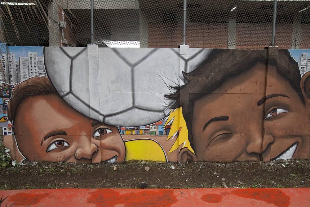 World Cup themed graffitti on a metro line wall near the Arena Corinthians stadium in Sao Paulo
