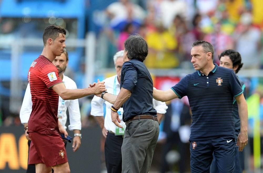 Joachim Loew of Germany and Portugal's Paulo Banto cheer Cristiano Ronaldo