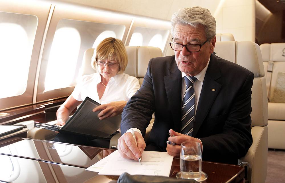 German Federal President Joachim Gauck (R) and his partner Daniela Schadt