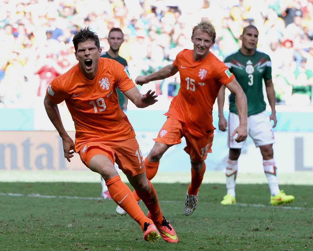 Klaas-Jan Huntelaar (L) of the Netherlands celebrates his goal