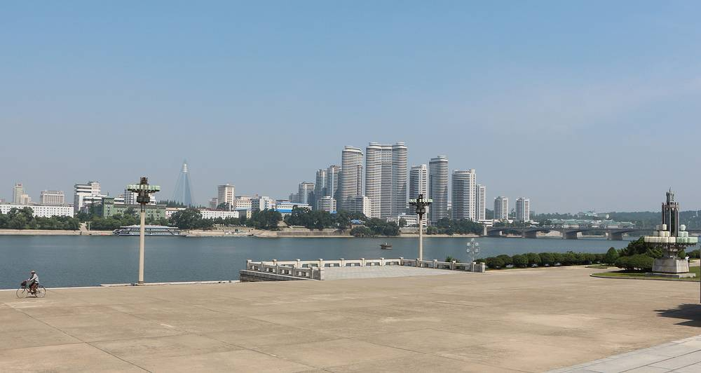 The Taedong River flows through Pyongyang. Across the river there's a new residential block