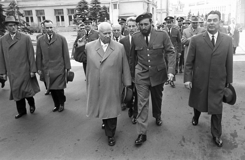 Soviet leaders Nikita Khrushchev and Leonid Brezhnev walk with Fidel Castro accompanied by Soviet ministers in Moscow, 1964